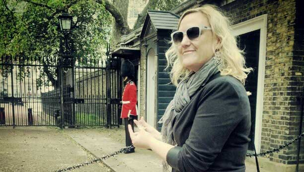 Shannon Fisher pretending to pinch a royal guard's bum