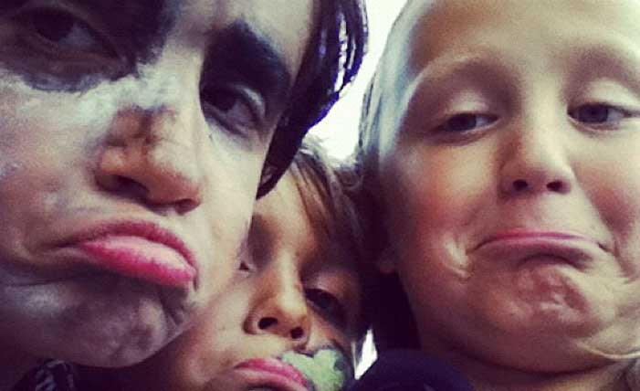 Funny close up of two boys and a girl with makeup