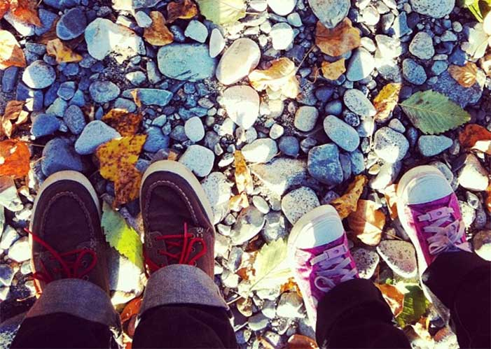 Feet walking on a river bed