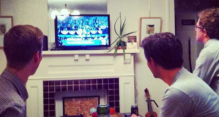Three guys watching Obama win the election